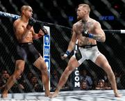 12 November 2016; Conor McGregor, right, in action against Eddie Alvarez during their lightweight title bout at UFC 205 in Madison Square Garden, New York. Photo by Adam Hunger/Sportsfile