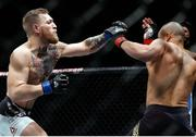 12 November 2016; Conor McGregor, left, in action against Eddie Alvarez during their lightweight title bout at UFC 205 in Madison Square Garden, New York. Photo by Adam Hunger/Sportsfile
