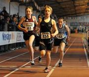 2 April 2011; Stefan McCrossan, Letterkenny, Co. Donegal, crosses the line ahead of Cormac Dalton, left, Mullingar Harriers, Co. Westmeath, and Mark Fennell, St. Mary's, Co. Clare, during the U14-Boy's 800m during the Woodie's DIY Juvenile Indoor Championships. Nenagh Indoor Stadium, Nenagh, Co. Tipperary. Picture credit: Barry Cregg / SPORTSFILE