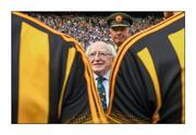 "4 September 2016; In time-honoured tradition. The President of Ireland, Michael D Higgins, also framed by the black and amber, meets the defending champions before the parade  Photo by Brendan Moran/Sportsfile  This image may be reproduced free of charge when used in conjunction with a review of the book ""A Season of Sundays 2016"". All other usage © SPORTSFILE"