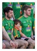 """28 February 2016; 15 + 1. Meath mascot Patrick Gaughran, aged 5 from Robinstown, lines up beside Donal Keogan and Darragh Smyth before Meath's home reversal to Cavan  Picture credit: Ray McManus / SPORTSFILE  This image may be reproduced free of charge when used in conjunction with a review of the book """"A Season of Sundays 2016"""". All other usage © SPORTSFILE"""