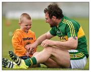 "1 May 2016; When all is said and done. Kerry's Mikey Boyle catches up with his two-year-old son Bobby after the county's Leinster qualifier victory over Carlow  Picture credit: Matt Browne / SPORTSFILE  This image may be reproduced free of charge when used in conjunction with a review of the book ""A Season of Sundays 2016"". All other usage © SPORTSFILE"