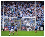 """4 June 2016; Blue army mobilised. Not even the travelling legion of Dubs in Nowlan Park can suck Diarmuid Connolly's penalty into the net. Laois goalkeeper Graham Brody dives left and saves  Photo by Ray McManus/Sportsfile  This image may be reproduced free of charge when used in conjunction with a review of the book """"A Season of Sundays 2016"""". All other usage © SPORTSFILE"""
