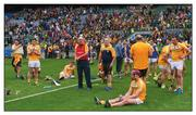 "4 June 2016; Down, but not out. The Antrim hurlers occupy the losers' enclosure following what appeared to be a defeat to Meath in the Christy Ring Cup final. A scoring error sees the game replayed  Photo by Piaras Ó Mídheach/Sportsfile  This image may be reproduced free of charge when used in conjunction with a review of the book ""A Season of Sundays 2016"". All other usage © SPORTSFILE"