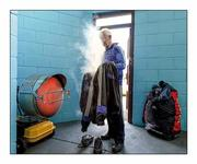 "3 January 2016;    Steaming up. Monaghan kitman Francis McGinnity uses the heating facilities in Clones to dry the team's gear before the match against Jordanstown  Picture by Philip Fitzpatrick / SPORTSFILE  This image may be reproduced free of charge when used in conjunction with a review of the book ""A Season of Sundays 2016"". All other usage © SPORTSFILE"
