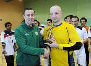 9 April 2011; Liam McGroarty, from the FAI, presents the player of the match trophy to the Blue Magic goalkeeper Rafal Wirkus. FAI Futsal Cup Final, EID Futsal v Blue Magic,  Gormanston College, Gormanston, Co. Meath. Picture credit: Matt Browne / SPORTSFILE
