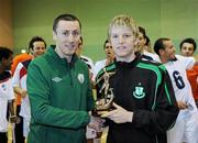 9 April 2011; Liam McGroarty, from the FAI, presents the player of the year trophy to the Shamrock Rovers player Ian Byrne. FAI Futsal Cup Final, EID Futsal v Blue Magic,  Gormanston College, Gormanston, Co. Meath. Picture credit: Matt Browne / SPORTSFILE