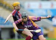 17 April 2011; Ursula Jacob, Wexford, in action against Sarah Dervan, Galway. Irish Daily Star Camogie League, Division 1, Final, Galway v Wexford, Semple Stadium, Thurles, Co. Tipperary. Picture credit: Brian Lawless / SPORTSFILE