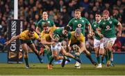 26 November 2016; Joey Carbery of Ireland is tackled by Will Genia, left, David Pocock and Michael Hooper of Australia during the Autumn International match between Ireland and Australia at the Aviva Stadium in Dublin. Photo by Brendan Moran/Sportsfile