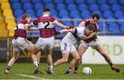 27 November 2016; Tomas Quinn of St. Vincent's is tackled by Patrick Fox, left, Simon Cadam, centre, and David McGivney of St. Columbas during the AIB Leinster GAA Football Senior Club Championship Semi-Final game between St. Columbas and St. Vincent's at Glennon Bros Pearse Park in Longford. Photo by Ramsey Cardy/Sportsfile