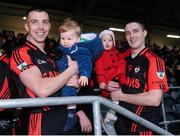 27 November 2016; Kenmare players Mark Crowley, with his son Flynn Crowley, and Shane Dalton with his daughter Eabha Dalton, aged 1, celebrate after the AIB Munster GAA Football Intermediate Club Championship Final between Kenmare and Adare at Mallow GAA Complex in Mallow, Co Cork. Photo by Diarmuid Greene/Sportsfile