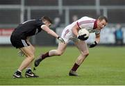 27 November 2016; Patsy Bradley of Slaughtneil in action against Aaron Branagan of Kilcoo during the AIB Ulster GAA Football Senior Club Championship Final game between Slaughtneil and Kilcoo at the Athletic Grounds in Armagh. Photo by Oliver McVeigh/Sportsfile