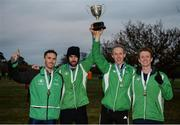 27 November 2016; Raheny Shamrock A.C. athletes, left to right, Conor Dooney, Mick Clohisey, Mark Kirwan and Kevin Dooney, with the trophy after they won the Senior Men's Club Championship for the first time in club history during the Irish Life Health National Cross Country Championships at the National Sports Campus in Abbotstown, Co Dublin. Photo by Cody Glenn/Sportsfile
