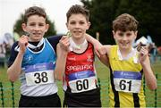 27 November 2016; Top three finishers in the Under 12 Boy's race, from left, second place Padraic Spillane, St. Laurence O'Toole A.C., first place Oisin Colhoun, Derry City Spartans A.C., and third place Tomas Haigney, Omagh Harriers, during the Irish Life Health National Cross Country Championships at the National Sports Campus in Abbotstown, Co Dublin. Photo by Cody Glenn/Sportsfile