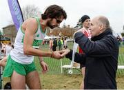 27 November 2016; Irish Life Health Managing Director Jim Dowdall presents Mick Clohisey of Raheny Shamrock A.C. with his second place medal following the Senior Men's race during the Irish Life Health National Cross Country Championships at the National Sports Campus in Abbotstown, Co Dublin. Photo by Cody Glenn/Sportsfile