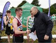 27 November 2016; Irish Life Health Managing Director Jim Dowdall presents Jack O'Leary, Mullingar Harriers, with his first place medal following the following the Junior Men's race during the Irish Life Health National Cross Country Championships at the National Sports Campus in Abbotstown, Co Dublin. Photo by Cody Glenn/Sportsfile