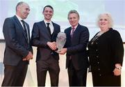 30 November 2016; Thomas Barr, second left, is presented with the Athlete of the Year award by Jim Dowdall, Managing Director at Irish Life Health, left, former 5000m world champion Eamon Coghlan, second right, and Georgina Drumm, President of Athletics Ireland, right, at the Irish Life Health National Athletics Awards 2016 at the Crowne Plaza Hotel in Santry, Dublin. Photo by Seb Daly/Sportsfile