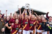 3 December 2016; St. Maurs captain Eadaoinn McGuinness lifts the cup as her team-mates celebrate after the All Ireland Junior Club Championship Final 2016 match between Kinsale and St. Maurs at Dr Cullen Park in Carlow. Photo by Matt Browne/Sportsfile