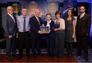 3 December 2016; Family members of the late referee Willie Walsh, Portlaoise, who refereed a total of nine All-Ireland Finals, including seven hurling and two football, grandson Seán Walsh, second from left, daughter Ita Power, fourth from left, granddaughter Máiréad Bourke, fifth from left, granddaughter Ursula Kenny, sixth from left, and great-grandson Neil Bourke, far right, accept the Hall of Fame Referee Presentation from Uachtarán Aogán Ó Fearghail, third from left, and Seán Walsh, far left, Chairman of National Referee Development Committee, at the GAA National Referees' Awards Banquet 2016 at Croke Park in Dublin. Photo by Cody Glenn/Sportsfile