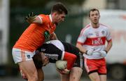 4 December 2016; Ben McKinless of Derry in action against Conor White of Armagh during the O'Fiaich Cup Semi-Final match between Armagh and Derry at St Oliver Plunkett Park in Crossmaglen, Co Armagh. Photo by Piaras Ó Mídheach/Sportsfile