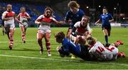 10 December 2016; Katie Fitzhenry of Leinster scores a try despite the tackle of Emma Jordan during the Women's Interprovincial Rugby Championship Round 2 match between Leinster and Ulster at Donnybrook Stadium in Dublin. Photo by Matt Browne/Sportsfile