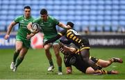 11 December 2016; Tiernan O'Halloran of Connacht is tackled by Marty Moore and Christian Wade of Wasps during the European Rugby Champions Cup Pool 2 Round 3 match between Wasps and Connacht at the Ricoh Arena in Coventry, England. Photo by Stephen McCarthy/Sportsfile