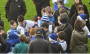 11 December 2016; St Vincent's captain Diarmuid Connolly signs autographs for supporters following their victory in the AIB GAA Football Senior Club Championship Final match between Rhode and St Vincent's at O'Moore Park in Portlaoise, Co. Laois. Photo by Ramsey Cardy/Sportsfile
