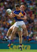 31 July 2016; Michael Quinlivan of Tipperary in action against Declan Kyne of Galway during the GAA Football All-Ireland Senior Championship Quarter-Final match between Galway and Tipperary at Croke Park in Dublin. Photo by Ray McManus/Sportsfile