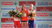 11 December 2016; Anna Emile Møller of Denmark, second place, left, Konstanze Klosterhalfen of Germany, first place, centre, and Harriet Knowles-Jones of Great Britain, third place, right, during the under 20 Women's race medal presentations at the 2016 Spar European Cross Country Championships in Chia, Italy. Photo by Eóin Noonan/Sportsfile