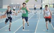 10 December 2016; Shane Monagle, centre, of Ireland, from Ard Scoil na Mara, Tramore, races alongside Joel McFarlane, left, of Scotland, from Camoustle HS, and Joshua Hewitt, right, of England, from Castle Rushen School, Isle of Man, during the Over 16 Boys 60m hurdles at the Combined Events Schools International games at Athlone IT in Co. Westmeath. Photo by Cody Glenn/Sportsfile