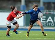 17 December 2016; Katie Fitzhenry of Leinster is tackled by Deirbhile Nic a Bhaird of Munster during the Women's Interprovincial Rugby Championship Round 3 match between Leinster and Munster at Donnybrook Stadium, Dublin. Photo by Piaras Ó Mídheach/Sportsfile