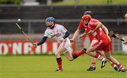 14 May 2011; Martin Grogan, Tyrone, in action against Mark Craig and Paddy Kelly, Derry. Ulster GAA Hurling Senior Championship, First Round, Tyrone v Derry, Healy Park, Omagh, Co. Tyrone. Picture credit: Oliver McVeigh / SPORTSFILE