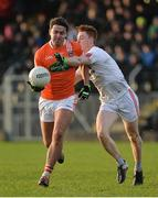 18 December 2016; Stefan Campbell of Armagh in action against Conor Meyler of Tyrone during the O'Fiaich Cup Final game between Armagh and Tyrone at Oliver Plunkett Park in Crossmaglen, Co. Armagh. Photo by Oliver McVeigh/Sportsfile