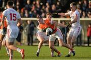 18 December 2016; Joe McElroy of Armagh in action against Niall McKenna of Tyrone during the O'Fiaich Cup Final game between Armagh and Tyrone at Oliver Plunkett Park in Crossmaglen, Co. Armagh. Photo by Oliver McVeigh/Sportsfile