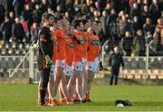 18 December 2016; The Armagh team stand for the National Anthem ahead of the O'Fiaich Cup Final game between Armagh and Tyrone at Oliver Plunkett Park in Crossmaglen, Co. Armagh. Photo by Oliver McVeigh/Sportsfile