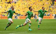 13 June 2016; Wes Hoolahan, centre, of Republic of Ireland celebrates after he scored his side's first goal during the UEFA Euro 2016 Group E match between Republic of Ireland and Sweden at Stade de France in Saint Denis, Paris, France. Photo by Stephen McCarthy/Sportsfile