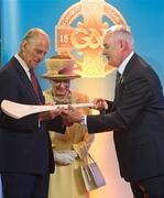 18 May 2011; Uachtarán CLG Criostóir Ó Cuana presents a hurley and sliothar to HRH the Duke of Edinburgh and HM Queen Elizabeth II during their tour of Croke Park. State Visit to Ireland by HM Queen Elizabeth II and HRH the Duke of Edinburgh, Croke Park, Dublin. Picture credit: Ray McManus / SPORTSFILE
