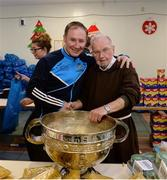 21 December 2016; Dublin footballer manager Jim Gavin with Br. Kevin Crowley and the Sam Maguire Cup as they lend a hand packing some of the 3,000 Christmas parcels for the homeless at the Capuchin Day Centre on Bow Street, Dublin. Photo by Piaras Ó Mídheach/Sportsfile