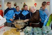21 December 2016; Dublin football manager Jim Gavin with Br. Kevin Crowley and the Sam Maguire Cup as they lend a hand packing some of the 3,000 Christmas parcels for the homeless at the Capuchin Day Centre on Bow Street, Dublin. Photo by Piaras Ó Mídheach/Sportsfile