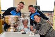25 December 2016; Patient Teresa Joyce, from Raheny, Dublin with her daughter Sarah Moran, Dublin manager Jim Gavin and team member Brian Fenton with the Sam Maguire Cup during a visit to Beaumont Hospital in Beaumount, Dublin.  Photo by Ray McManus/Sportsfile