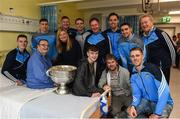 25 December 2016; Patient Christopher Joyce, from Finglas, Dublin, with his daughter Ann Dillon, his son in law Kenny Dillon and his grandson Sean with Dublin manager Jim Gavin, selector Shane O'Hanlon, team captain Stephen Cluxton, and team members Tomás Brady, Brian Fenton, Ciaran Kilkenny, James McCarthy, John Small, Paul Mannion and the Sam Maguire Cup during a visit to Beaumont Hospital in Beaumount, Dublin.  Photo by Ray McManus/Sportsfile