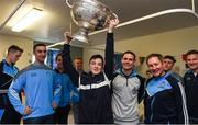 25 December 2016; Dublin manager Jim Gavin,  team captain Stephen Cluxton, and team members James McCarthy, and Ciaran Kilkenny look on as Joe Tuohy, 14 years, from Castlebar Mitchells, lifts the Sam Maguire Cup during a visit by the Dublin players to Beaumont Hospital in Beaumount, Dublin. Joe was in the hopspital to visit his sister Lucy who is a patient.  Photo by Ray McManus/Sportsfile