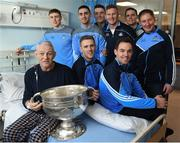 25 December 2016; Patient John Kelly, from Letterkenny, Co. Donegal, with Dublin manager Jim Gavin, team captain Stephen Cluxton and team members Tomás Brady, Brian Fenton, Ciaran Kilkenny, James McCarthy, John Small, Paul Mannion and the Sam Maguire Cup during a visit to Beaumont Hospital in Beaumount, Dublin. Photo by Ray McManus/Sportsfile