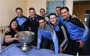 25 December 2016; Patient Maria Tierney with Dublin manager Jim Gavin team captain Stephen Cluxton, and team members Tomás Brady, Brian Fenton, Ciaran Kilkenny, James McCarthy, John Small, Paul Mannion and the Sam Maguire Cup during a visit to Beaumont Hospital in Beaumount, Dublin. Photo by Ray McManus/Sportsfile