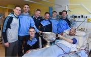25 December 2016; Patient Andrew Conlon, from Dundalk, Co. Louth, with Dublin manager Jim Gavin, team captain Stephen Cluxton, and team members Tomás Brady, Brian Fenton, Ciaran Kilkenny, James McCarthy, John Small and the Sam Maguire Cup during a visit to Beaumont Hospital in Beaumount, Dublin. Photo by Ray McManus/Sportsfile