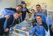 25 December 2016; Patient Joan Farrell, from Santry, Dublin, with Dublin manager Jim Gavin, team captain Stephen Cluxton and team members Tomás Brady, Brian Fenton, Ciaran Kilkenny, James McCarthy, John Small, Paul Mannion and the Sam Maguire Cup during a visit to Beaumont Hospital in Beaumount, Dublin. Photo by Ray McManus/Sportsfile