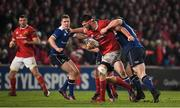 26 December Jean Kleyn of Munster is tackled by Cian Healy of Leinster during the Guinness PRO12 Round 11 match between Munster and Leinster at Thomond Park in Limerick. Photo by Brendan Moran/Sportsfile