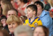 22 May 2011; A young Clare supporter watches the game. Munster GAA Football Senior Championship Quarter-Final, Cork v Clare, Pairc Ui Chaoimh, Cork. Picture credit: Pat Murphy / SPORTSFILE
