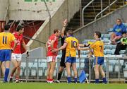 22 May 2011; Graham Kelly, Clare, 10, is shown the red card by referee Eddie Kinsella before headbutting Cork's John Miskella, left. Munster GAA Football Senior Championship Quarter-Final, Cork v Clare, Pairc Ui Chaoimh, Cork. Picture credit: Pat Murphy / SPORTSFILE