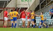 22 May 2011; Graham Kelly, Clare, second from right, headbutts Cork's John Miskella after being shown the red card by referee Eddie Kinsella. Munster GAA Football Senior Championship Quarter-Final, Cork v Clare, Pairc Ui Chaoimh, Cork. Picture credit: Pat Murphy / SPORTSFILE